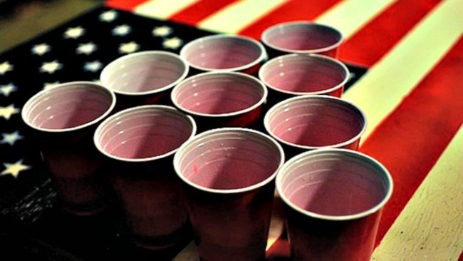 Solo cups on American flag signifying American Alcohol Addiction