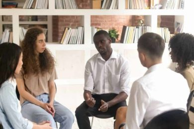 Millennials in group therapy for addiction treatment.